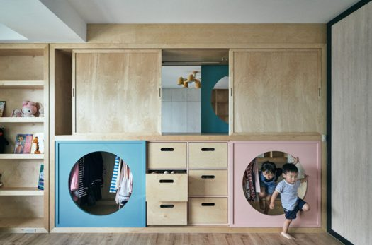 HAO Design have created a unique wardrobe that connects a play room with the children's bedroom. Round-shaped doors allow the children to easily pass through between the rooms, and evoke the joy of playing hide-and-seek. #InteriorDesign #Wardrobe #Closet #Playroom