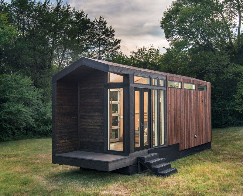 New Frontier Tony Homes have designed the Orchid Tiny House, that has a contemporary, gable farmhouse design. #TinyHouse #TinyHome #Architecture #Design #InteriorDesign