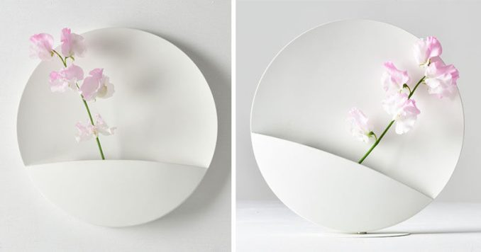 Shinya Oguchi has designed 'Picture', a minimalist white flower vase that has a strong magnet allowing the user to change the angle of the vase. #Vase #HomeDecor #Design