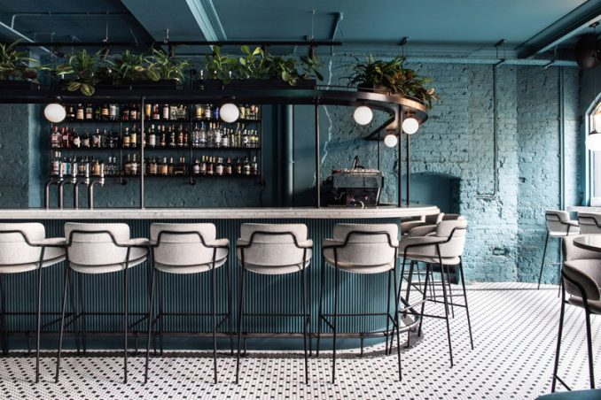 Australian based design studio Biasol has recently completed Greenwich Grind, a coffee-and-cocktail restaurant that's located opposite the famous Greenwich Market in London, England. #BarDesign #Restaurant #ModernBar