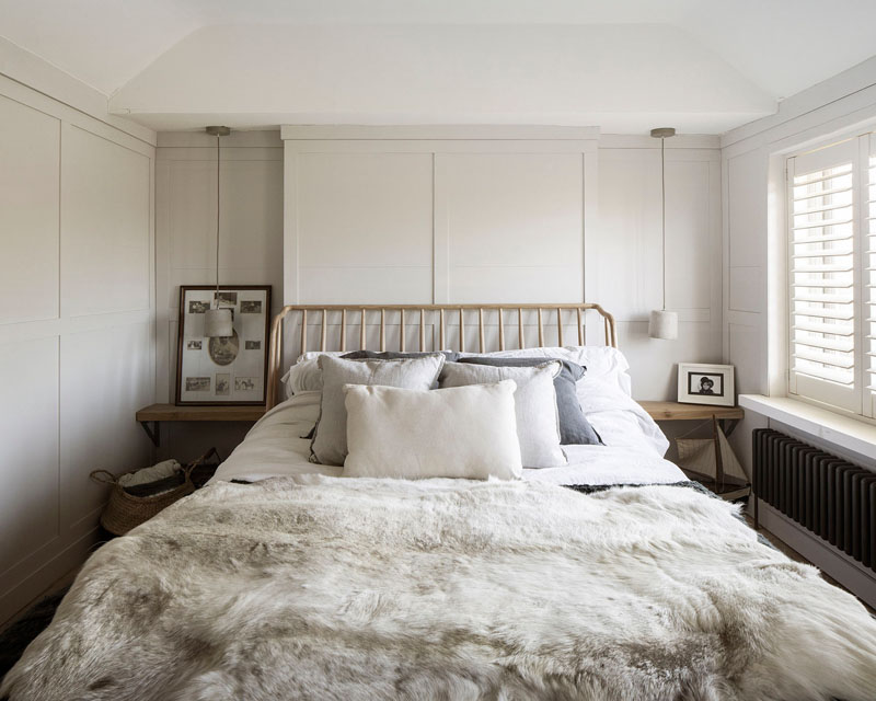 This updated bedroom retains the charm and character of the original house. #BedroomDesign