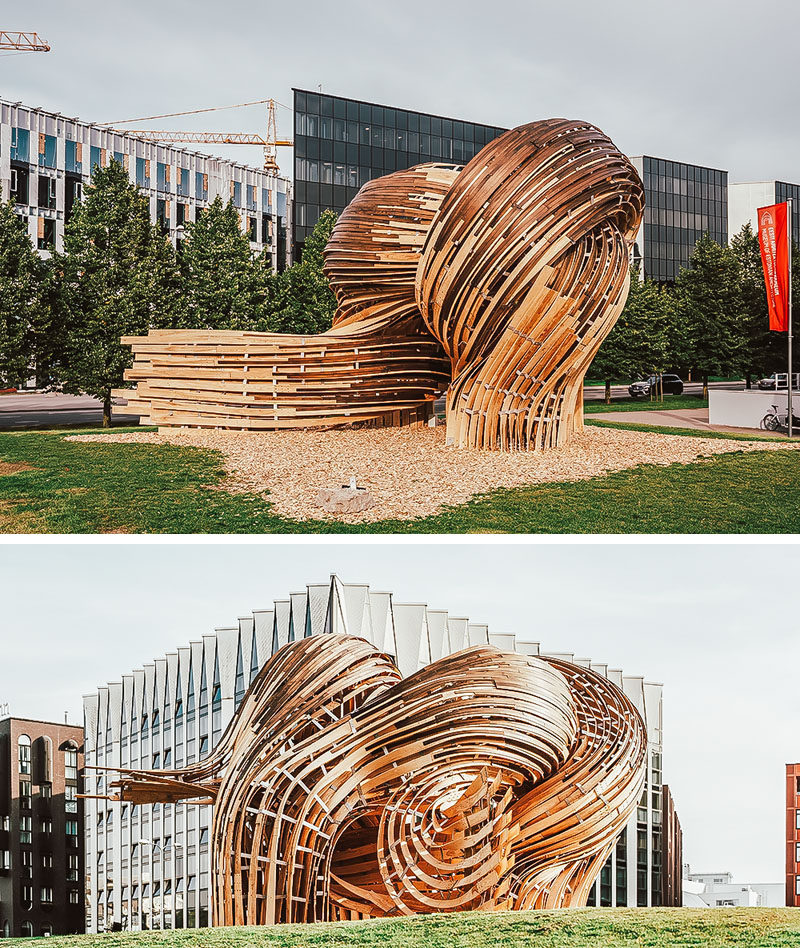 Sculpture Ideas - Using analogue tools augmented with the precision of mixed reality environments, the designers of this modern sculpture were able to create the curved shape that makes the wood appear as if it's flowing. #Sculpture #PublicArt