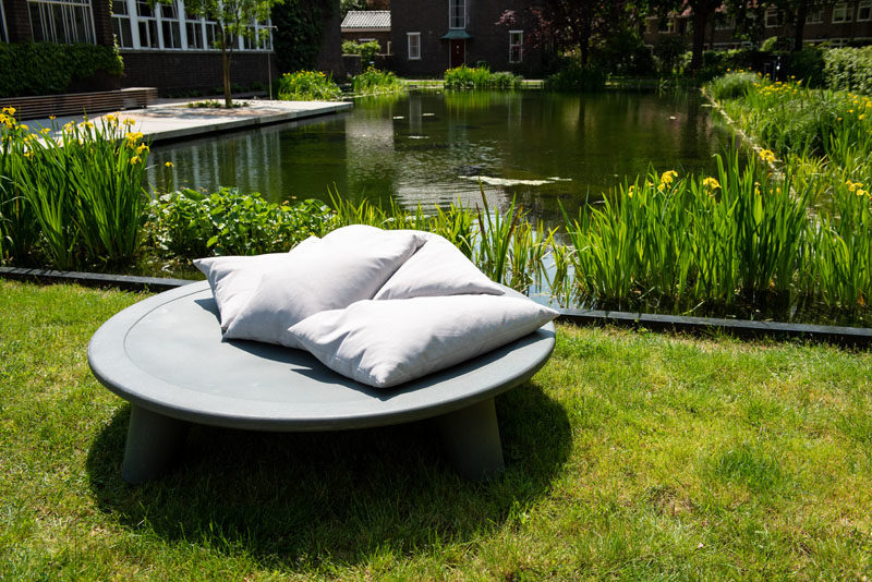 Outdoor Furniture Ideas - Weltevree has collaborated with designer Joep van Lieshout, to create 'The Flying Dishman', an outdoor daybed that's partly made from recycled waste containers. #Daybed #OutdoorFurniture #OutdoorDaybed #OutdoorLounge