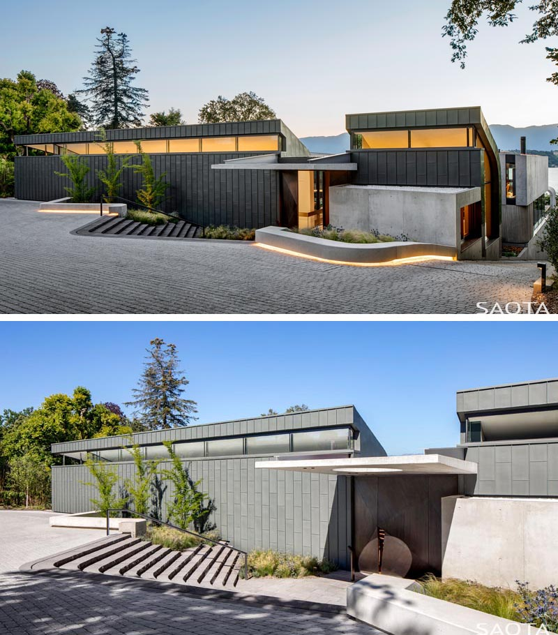 The exterior of this modern house features Zinc cladding, while lighting at night shows off the lines of the house, and guide visitors to the front door. #ZincCladding #ModernHouse #ModernArchitecture