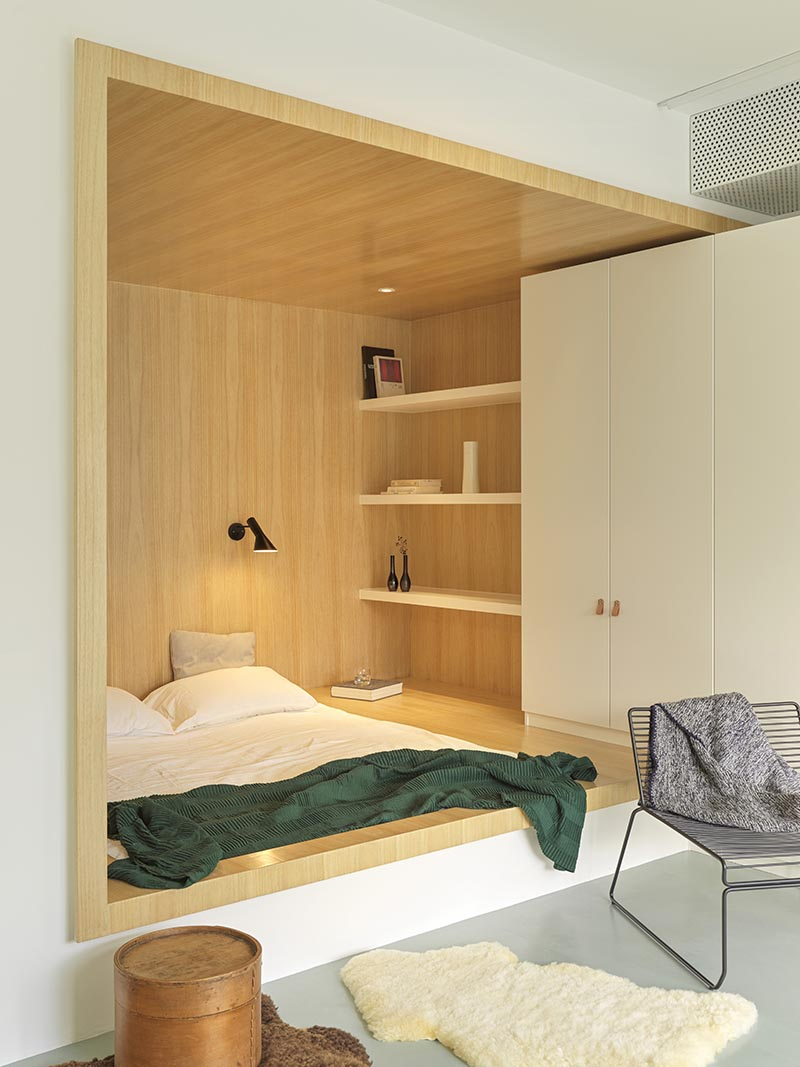 built in bed within a wood lined niche