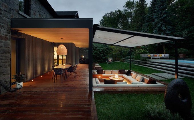 A covered outdoor dining area and sunken conversation pit with a fire bowl.