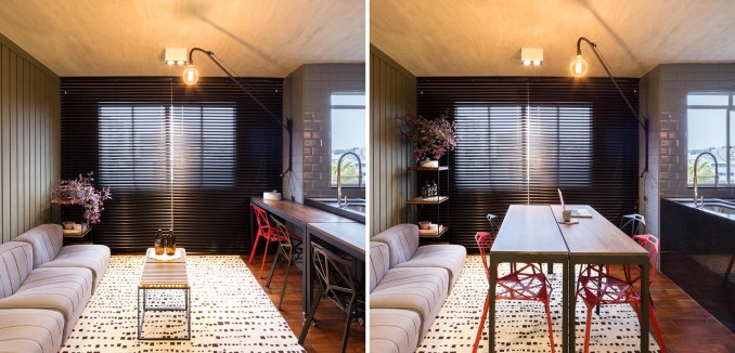 A modern apartment that has tables on wheels that can move to turn the living room into a dining room.
