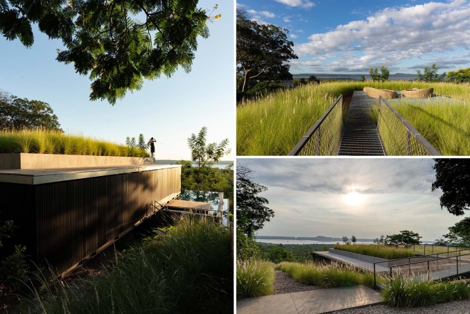 This modern rooftop patio is surrounded by grasses and is furnished with a pair of low day beds. From the rooftop, you can see the surrounding landscape and views of the water.