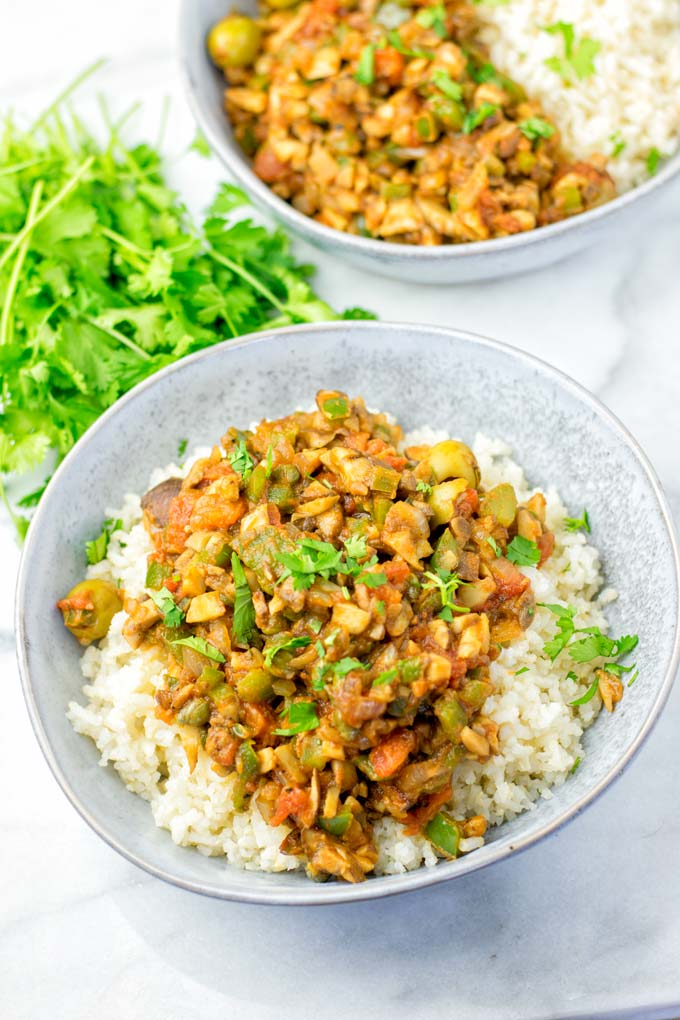Cuban Picadillo served in a bowl over rice.