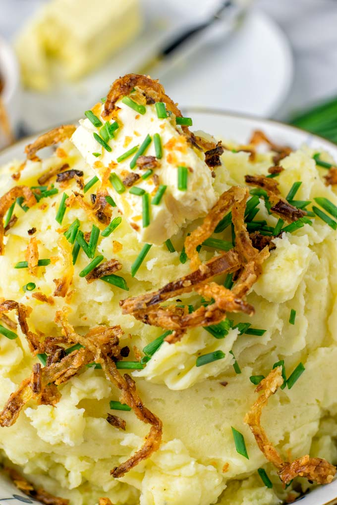 Creamy and so flavorful, these Garlic Mashed Potatoes should be on every holiday table.
