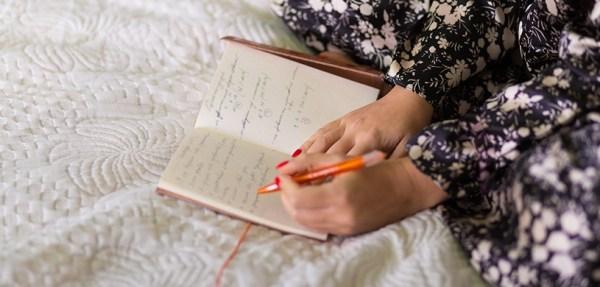 écrire dans son lit