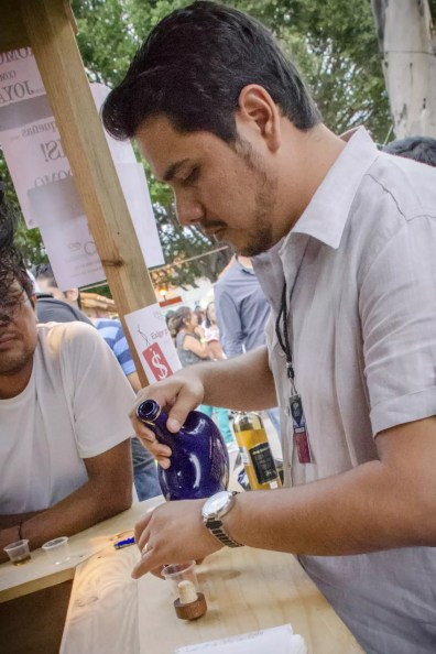 Oaxaca Mezcal Festival: Pouring from the blue bottle