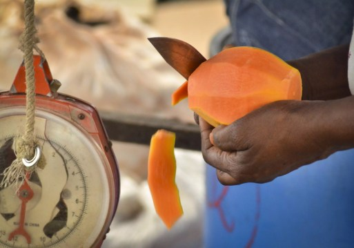 Jamaica Vacations: A lady cuts a papaya