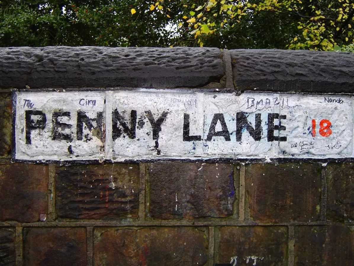 A street sign planted on a wall at Penny Lane