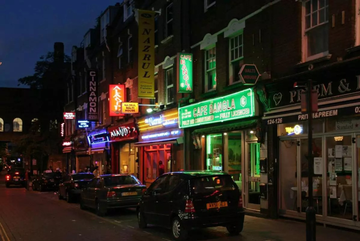 Curry shops on Brick Lane - Eat Well in London - Photo credit: ahisgett under CC BY 2.0