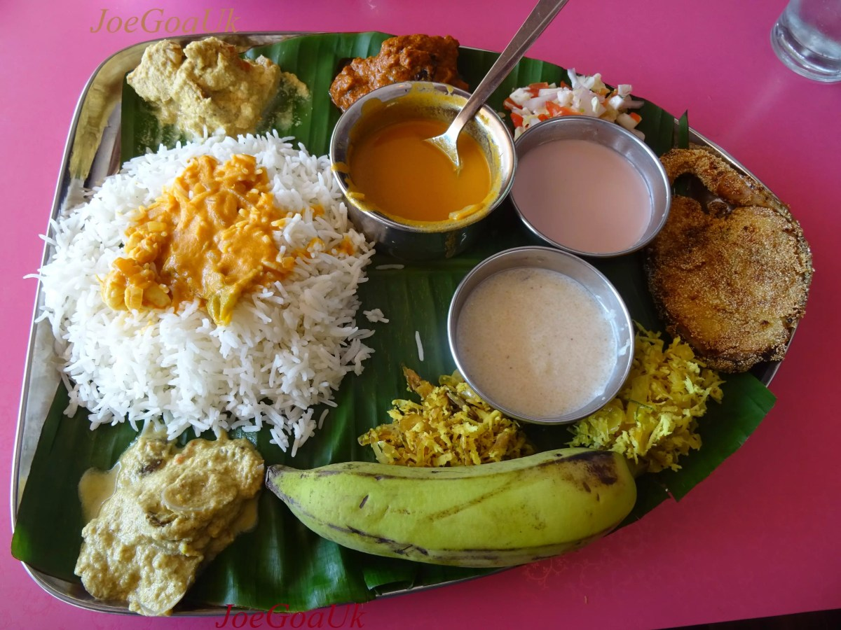 Anthony Bourdain Malaysia Penang - Variety of curry dishes placed on banana leaf