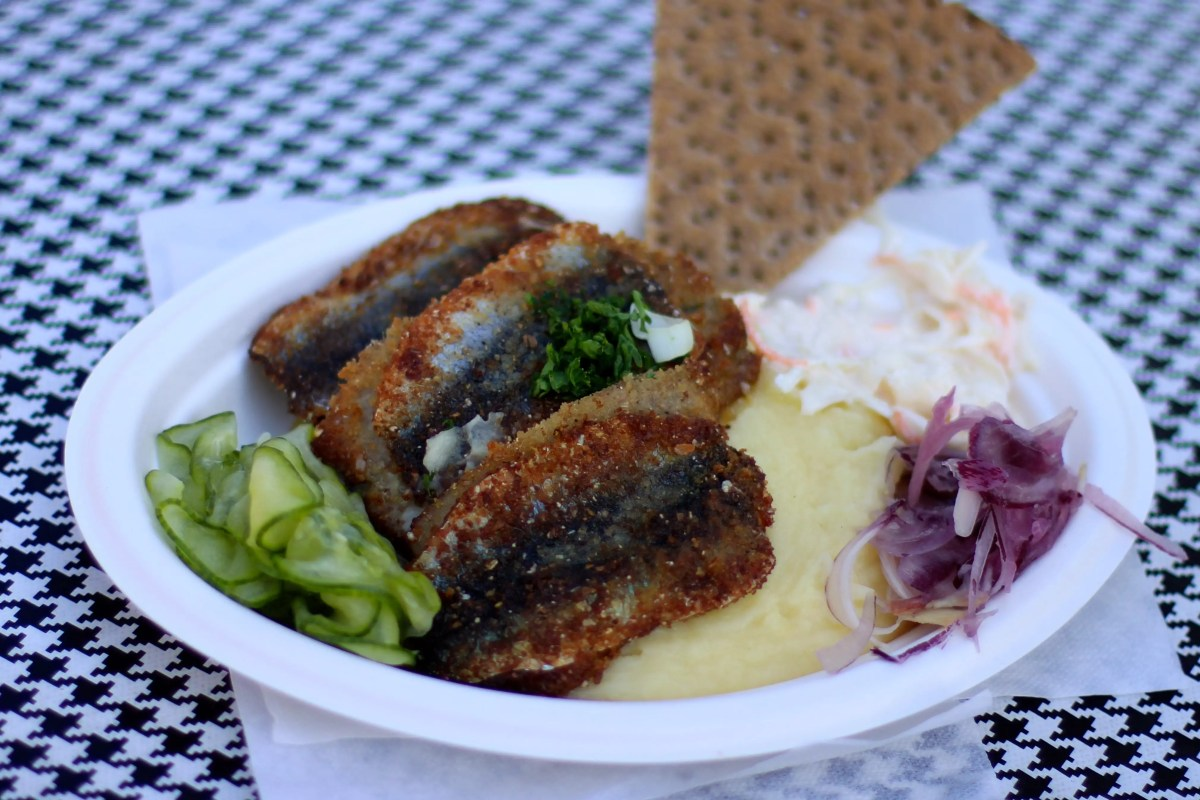 Fried Herring with bread and vegetable side dish