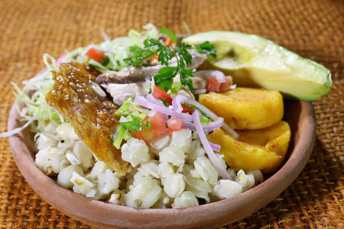Chancho and Llapingachos - photo by amalavida.tv from Ecuador under CC BY-SA 2.0