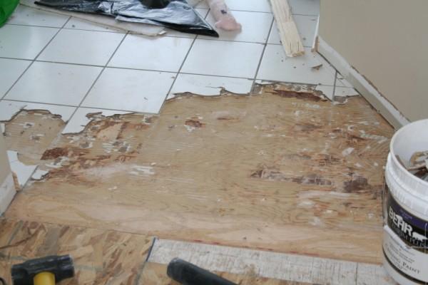 removing porcelain tile on stapled and