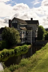 A view of the moat and south front of Little Moreton Hall, Cheshire