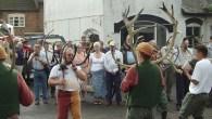 A curious horn dance with Maid Marian, a hobby horse and a fool