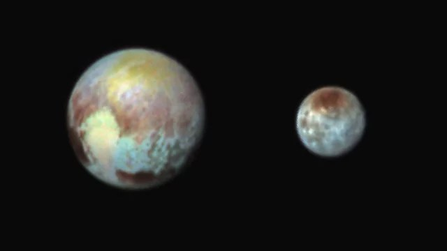 Pluto and it's moon Charon Shine in False Color - NASA Goddard Space Flight Center (CC BY 2.0)