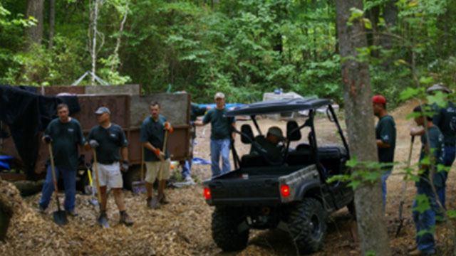 truck in woods around convergint workers header image