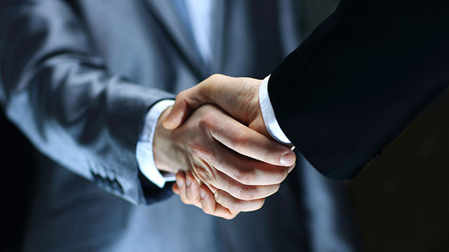 Two Males Handshake header image