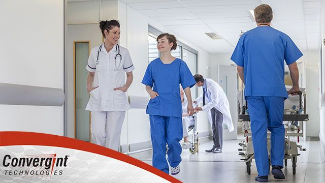 Nurse and doctor walking with Convergint Logo