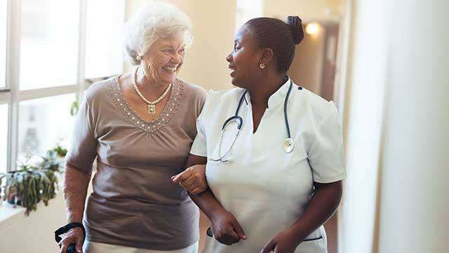 Nurse assisting senior women header image