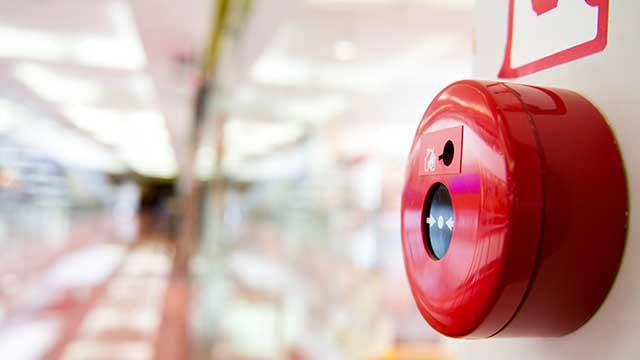 Fire alarm on the wall of shopping center header image