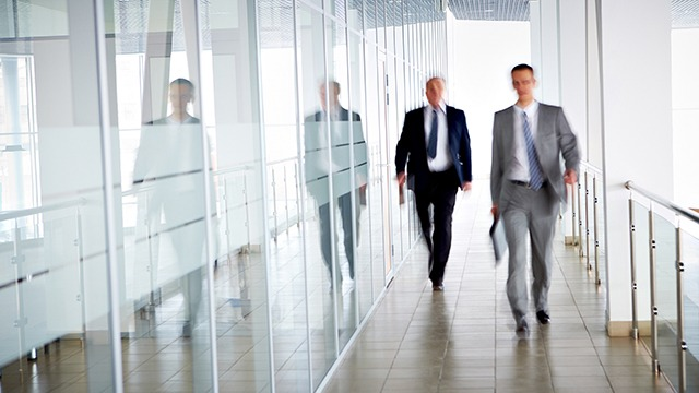 People in office walking header image
