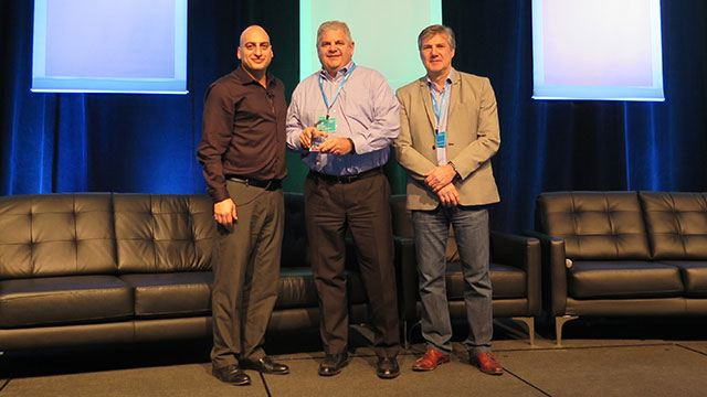 Tony Varco receiving award on stage for Genetec NA account of the year header image