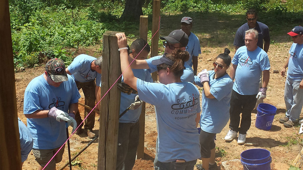 Convergint Day Colleagues Constructing a fence