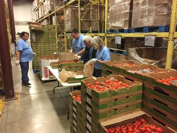 Convergint colleagues at local food bank working