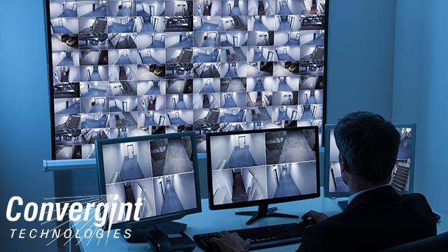 Guy sitting at desk looking at cameras
