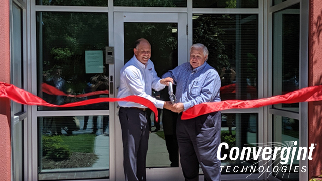 Convergint colleague and mayor cutting ribbon