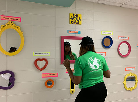 Woman posing in new inspirational mirrors for children at school