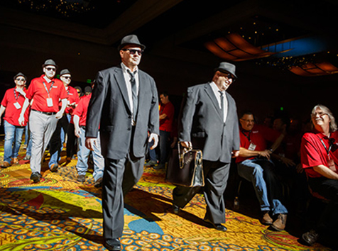 People dressed as Blues Brothers characters