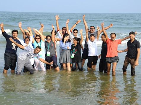 People posing on the beach