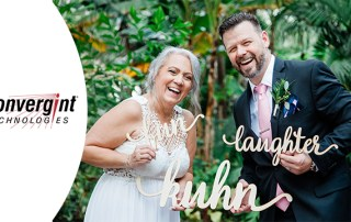 Bride and groom pose with word cutouts