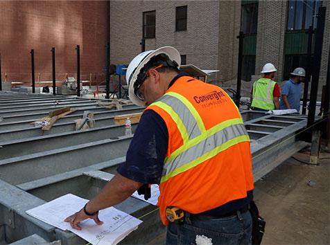 man looking at blueprints