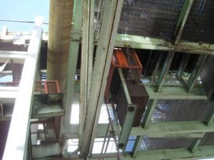 Bottom view of old rusted conveyor system