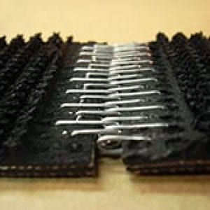 close up of recessed lacing holding to two sections of conveyor belting together