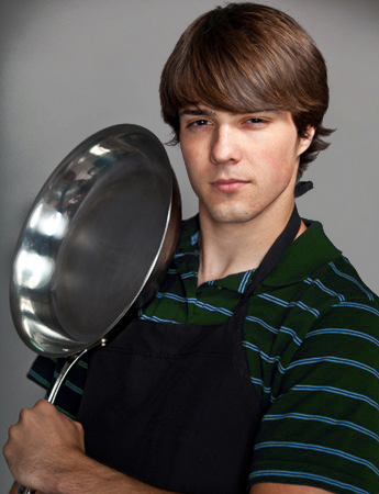 College boy ready to cook with the help of his recipe binder