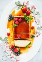 flan with berries and mint, sliced into.