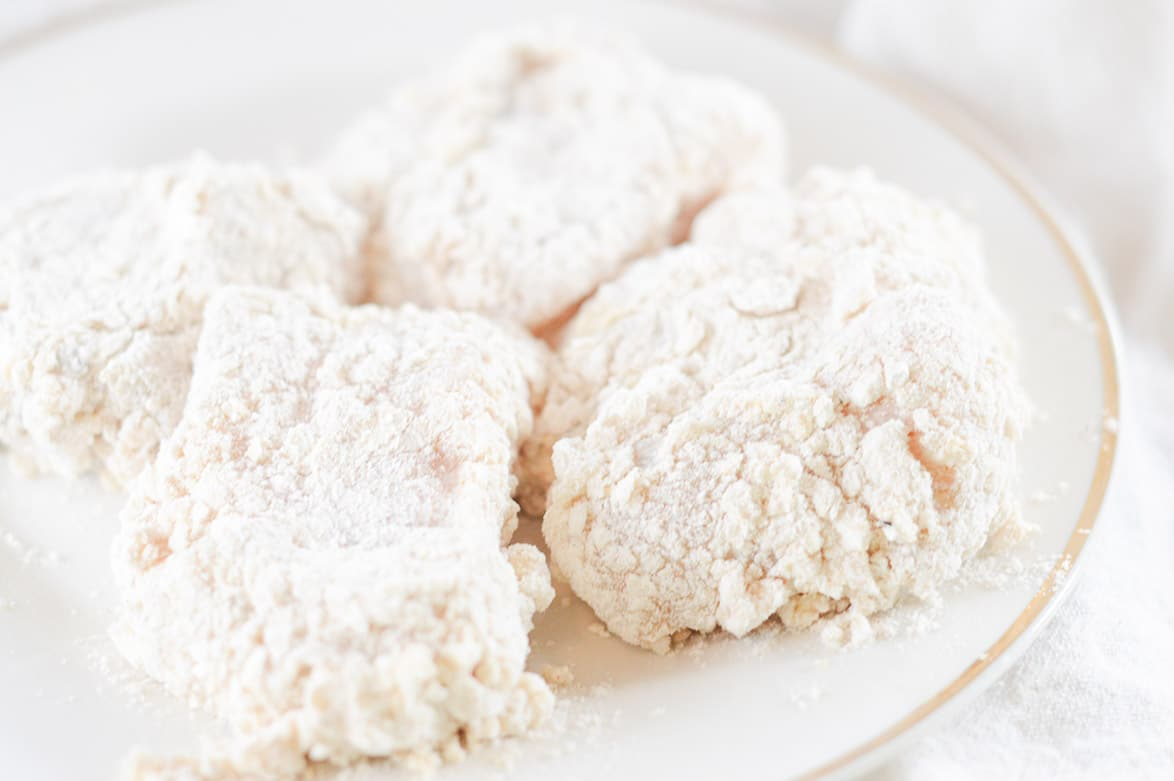 raw chicken coated with seasoned flour