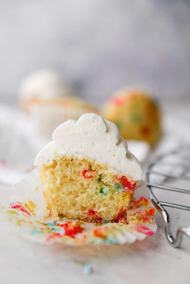 funfetti cupcake sliced in half up close.