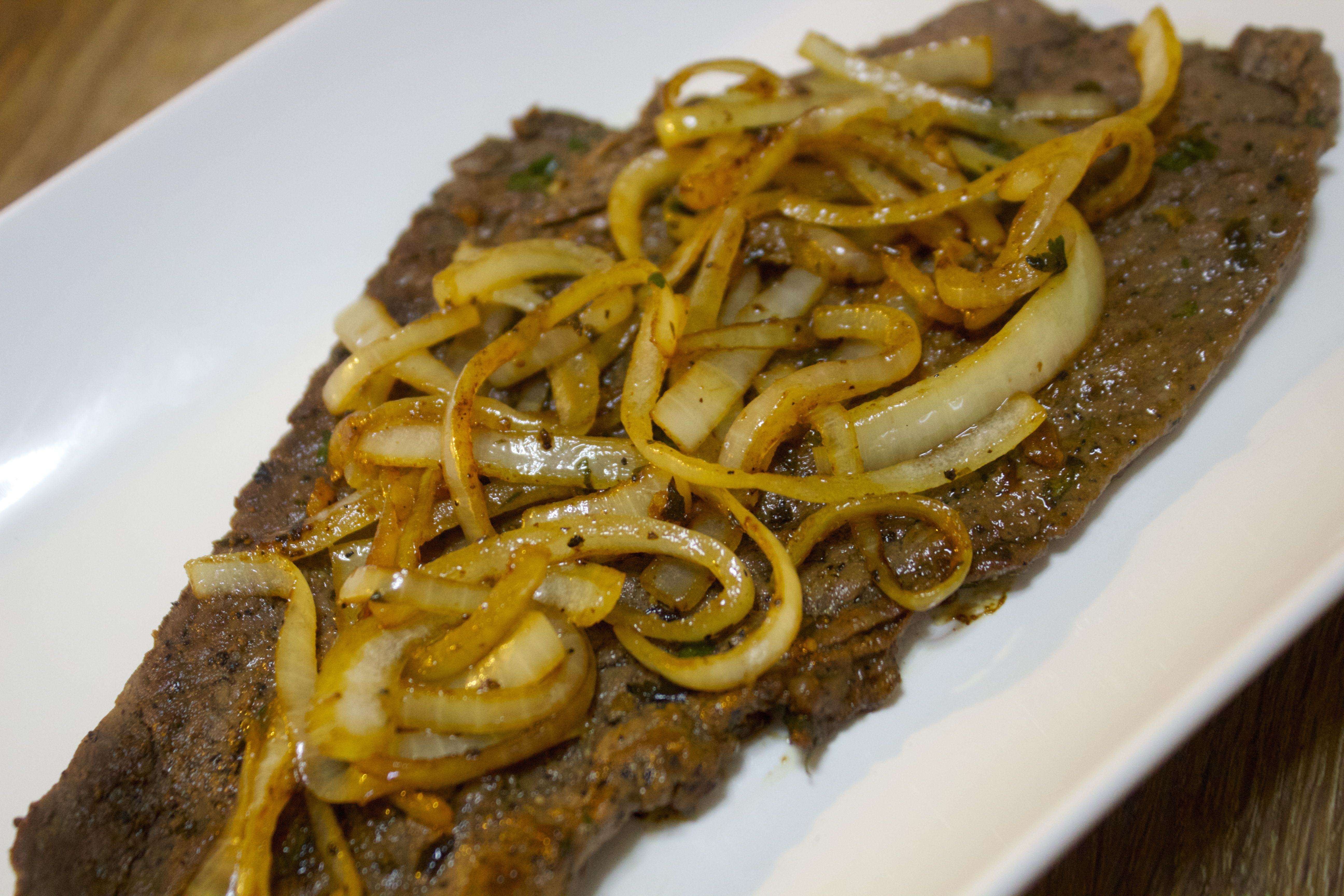 This Bistec Encebollado, or Cuban steak and onions recipe is tender and delicious, and packed with flavor.