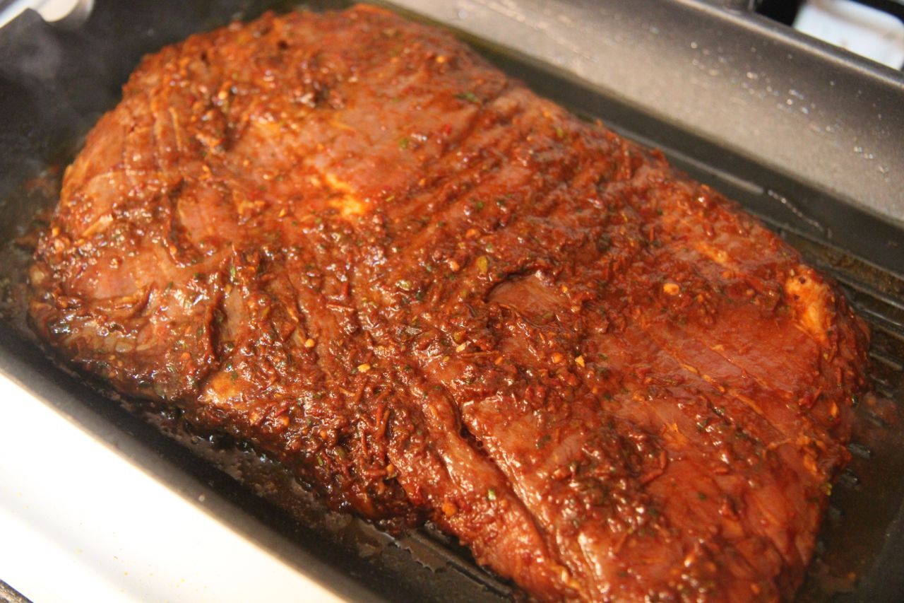 Marinate the flank steak with the pepper sauce for juicy, flavorful steak